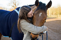 Kiss from young rider for Cleveland Bay Cross Thoroughbred horse, Oxfordshire, United Kingdom.