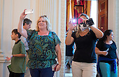Tourists use their cell phone cameras to take photos during their tours of the White House in Washington, D.C. on Wednesday, July 1, 2015. The White House announced it lifted its longstanding ban on photos during public tours.  This ban has been in place for over 40 years.  Effective today, guests are now welcome to take photos during their tours of the White House. <br /> Credit: Ron Sachs / Pool via CNP