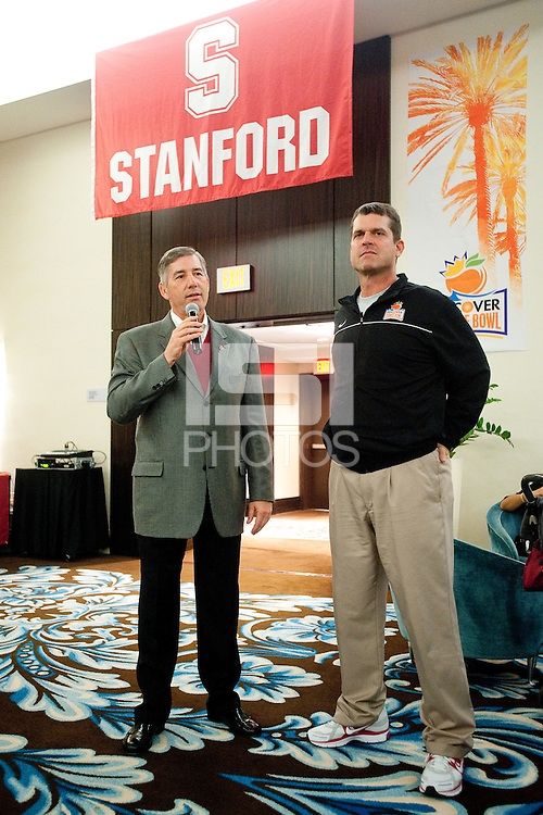 MIAMI, FL--Bob Bowlsly and Coach Jim Harbaugh express their thanks to the Orange Bowl hosts at the FontaineBleau Hotel in Miami, Florida.