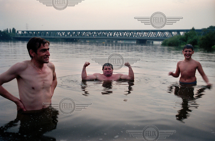 Bulgarian immigrants swim in the Elbe River, which separates Hamburg from the island suburb of Wilhemsburg, which is one of the most ethnically diverse quarters of the city.