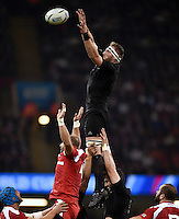 Kieran Read of New Zealand rises high to win lineout ball. Rugby World Cup Pool C match between New Zealand and Georgia on October 2, 2015 at the Millennium Stadium in Cardiff, Wales. Photo by: Patrick Khachfe / Onside Images
