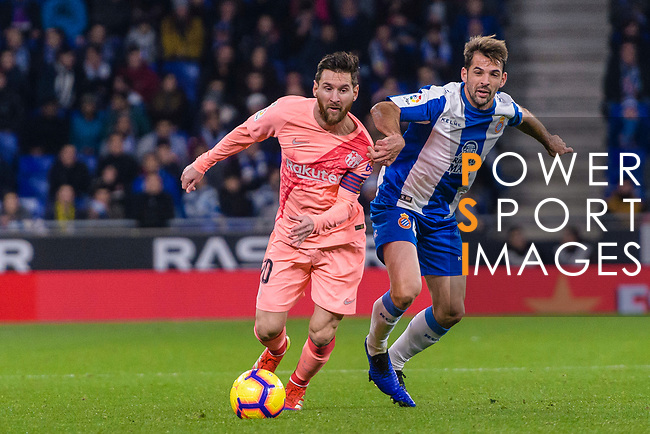 Lionel Messi of FC Barcelona (L) in action against Victor Sanchez of RCD Espanyol (R) during the La Liga 2018-19 match between RDC Espanyol and FC Barcelona at Camp Nou on 08 December 2018 in Barcelona, Spain. Photo by Vicens Gimenez / Power Sport Images
