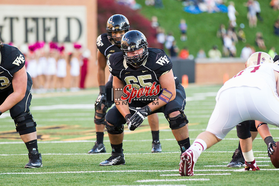 Josh T. Harris (65) of the Wake Forest Demon Deacons on offense during second half action against the Boston College Eagles at BB&T Field on October 25, 2014 in Winston-Salem, North Carolina.  The Eagles defeated the Demon Deacons 23-17.  (Brian Westerholt/Sports On Film)