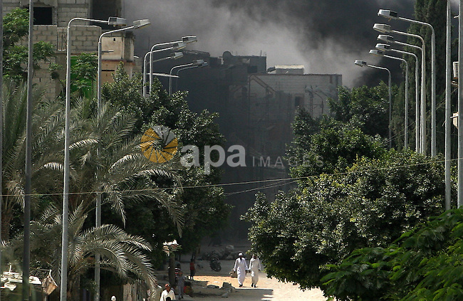 Smoke rises in the Egyptian city of Rafah, near the border with southern Gaza Strip September 1, 2013. Egyptian security forces have stepped up a crackdown campaign since July on smuggling tunnels dug beneath the Gaza-Egypt border, Hamas officials said. Photo by Eyad Al Baba