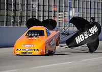 Nov 13, 2010; Pomona, CA, USA; NHRA top alcohol funny car driver Tony Bartone during qualifying for the Auto Club Finals at Auto Club Raceway at Pomona. Mandatory Credit: Mark J. Rebilas-