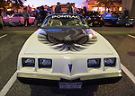 Bellmore, New York, USA. 7th August 2015. A white 1980 Pontiac Turbo-Trans Am, with large eagle decal sticker on hood, is displayed at the Friday Night Car Show held at the Bellmore Long Island Railroad Station Parking Lot. On side of car a decal states 'Official Pace Car, Torbo-Trans Am, 64th Annual Indianapolis 500 Mile Car Race on May 25, 1980.' Hundreds of classic, antique, and custom cars were on view at the free weekly show, sponsored by the Chamber of Commerce of the Bellmores.