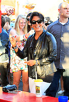Keeping up with the Kardashians: Kris Jenner treated her daughter_Kylie and a bunch of friends with a trip to the Orange County Fair in Costa Mesa on a sunny Saturday afternoon. The Jenners were accompanied by Cody_Simpson's sister Alli_Simpson and a whole entourage of bodyguards and production people, who made sure that the outing was caught on film. ..Before the gang headed to the concert of Cody_Simpson on the Fair grounds, Kris grabbed a deep fried sweet treat and some ice cream and throw darts with_Kylie to win a stuffed animal. ..Kylie_and her friend later skipped the line at a thrill ride, which caused a couple of BOOs among the waiting crowd. The duo held hands and screamed from the top of their lungs during the ride but they clearly had a lot of fun! Costa Mesa, California on 21.7.2012..Credit: Kilian/face to face / Mediapunchinc - ***NO PRINT FOR WEEKLY MAGAZINES ONLINE ONLY**** */*NortePhoto*<br />