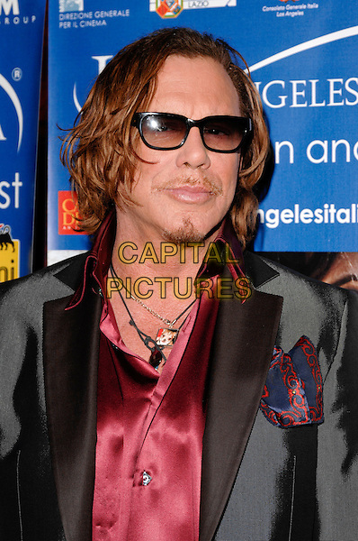 "MICKEY ROURKE (wearing a necklace with a photo of his recently deceased pet Chihuahua Loki).The 4th Los Angeles Italia Film, Fashion And Art Festival's U.S. premiere of ""Franco Cristaldi:An Italian Legend"", Mann Chinese 6 Theaters, Hollywood, California, USA..February 20th, 2009.headshot portrait sunglasses shades goatee facial hair necklaces red shirt .CAP/ROT.©Lee Roth/Roth Stock/Capital Pictures"