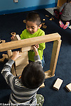 Education Preschool 3-4 year olds two boys working together building with blocks