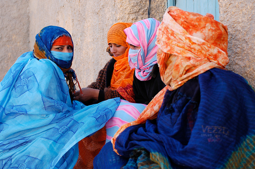 Some girls sit outside a hospital in Ausserd on December 13, 2003, in the Saharawi refugee camps. Saharawi people have been living at the refugee camps of the Algerian desert named Hamada, or desert of the deserts, for more than 30 years now. Saharawi people have suffered the consecuences of European colonialism and the war against occupation by Moroccan forces. Polisario and Moroccan Army are in conflict since 1975 when Hassan II, Moroccan King in 1975, sent more than 250.000 civilians and soldiers to colonize the Western Sahara when Spain left the country. Since 1991 they are in a peace process without any outcome so far. (Ander Gillenea / Bostok Photo)