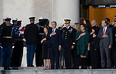 Members of the Bush family including former First Lady Laura Bush and President George W. Bush watch as a military casket team carries casket of former President George. H. W. Bush to the Capitol Rotunda in Washington, DC where he will lie state, December 3, 2018. Credit: Chris Kleponis / CNP
