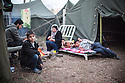 Syrian children at Harmanli, a former military camp near the Turkish border. Beginning in 2013, officials placed refugees inside military tents with only dirt floors even during the winter months, when it was cold and damp and many people suffered from respiratory infections.
