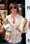 US actress Lisa Rinna arrives holding dolls at the world premiere of 'Kit Kittredge: An American Girl' at the Grove in Los Angeles, California on 14 June 2008. The film is based on the American Girl doll line and centers on Kit Kittredge, a young woman who grows up in the early years of the Great Depression.