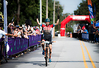 NWA Democrat-Gazette/CHARLIE KAIJO Keegan Swenson of Heber City, Utah reacts as he crosses the finish line to place first in the men's race of the Epic Rides Oz Trails championship mountain bike race, Sunday, October 7, 2018 at the downtown square in Bentonville.<br />