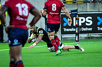Hurricanes' Blade Thomson scores during the Super Rugby match between the Hurricanes and Reds at Westpac Stadium in Wellington, New Zealand on Friday, 18 May 2018. Photo: Dave Lintott / lintottphoto.co.nz