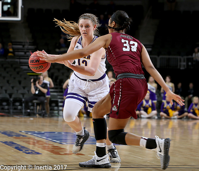 SIOUX FALLS, SD: MARCH 7: Morgan Blumer #12 from Western Illinois drives against Mikale Rogers #33 from IUPUI during the Women's Summit League Basketball Championship Game on March 7, 2017 at the Denny Sanford Premier Center in Sioux Falls, SD. (Photo by Dave Eggen/Inertia)