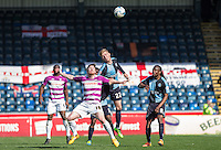 Jason McCarthy of Wycombe Wanderers beats Michael Gash of Barnet in the air during the Sky Bet League 2 match between Wycombe Wanderers and Barnet at Adams Park, High Wycombe, England on 16 April 2016. Photo by Andy Rowland.