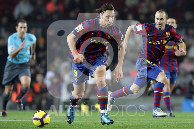 Football Season 2009-2010. Barcelona's player Zlatan Ibrahimovic and Andres Iniesta during their spanish liga soccer match at Camp Nou stadium in Barcelona. January 16, 2010.