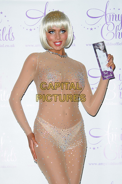 Amy Childs at a photocall to promote her new range of 'Hair Vajazzles' at the Worx Studios, London, England..16th May 2012.half length beige skin coloured colored leotard sheer hand on bum rear see through thru blonde bob wig beads beaded cleavage knickers underwear silver   .CAP/CJ.©Chris Joseph/Capital Pictures.