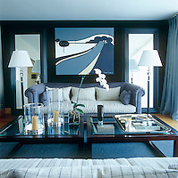 In the bedroom of this London apartment inspiration for the colour scheme came from the painting hanging on the black velvet wall