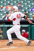 Jacob Lueneburg #42 of the Houston Cougars follows through on his swing against the Texas Tech Red Raiders at Minute Maid Park on February 28, 2014 in Houston, Texas.  The Cougars defeated the Red Raiders 9-0.  (Brian Westerholt/Four Seam Images)