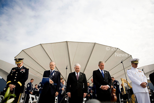 Major General Douglas Carver, United States Army Chief of Chaplains, left, Donald Rumsfeld, former U.S. Secretary of Defense, second left, Robert Gates, U.S. Secretary of Defense, center, U.S. President George W. Bush, second right, Admiral Michael Mullen and chairman of the Joint Chiefs of Staff bow their heads during a prayer at the dedication of the September 11th Memorial at the Pentagon on the 7th anniversary of the September 11, 2001 attacks on New York and Washington in Washington, DC, Thursday, September 11, 2008.<br /> Credit: Joshua Roberts / Pool via CNP