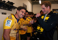 Prince Harry jokes with Cory Jane in the Hurricanes changing rooms after the Super Rugby match between the Hurricanes and Sharks at Westpac Stadium, Wellington, New Zealand on Saturday, 9 May 2015. Photo: Dave Lintott / lintottphoto.co.nz