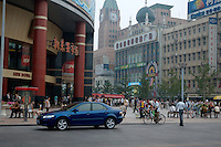 Crowds of shoppers walking around Wangfujing Mall, Beijing, China.