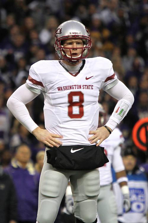 "Marshall Lobbestael (#8), Washington State quarterback, waits for the play call from the sidelines during the Cougars Pac-10 conference ""Apple Cup"" showdown with arch-rival Washington at Husky Stadium in Seattle, Washington, on November 28, 2009.  The Cougars lost to the Huskies in the game, 30-0."