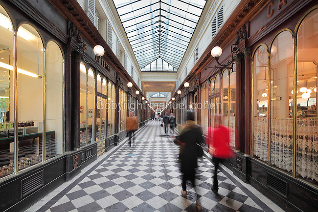 Galerie Vero-Dodat, covered shopping arcade built 1826 between the Rue de Jean-Jacques Rousseau and Rue de Croix-des-Petits-Champs, 1st arrondissement, Paris, France. The arcade is Neoclassical in style, with a tiled floor and wooden shop fronts. It was restored in 1997 and is listed as a historic monument. Picture by Manuel Cohen