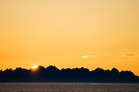 Later summer sunset over Lofoten Islands as seen from Vestfjord, Norway