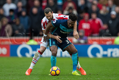 March 4th 2017,  bet365 Stadium, Stoke, England; EPL Premier League football, Stoke City versus Middlesbrough; Middlesbrough's Adama Traore and Stoke's Erik Pieters fight over the ball