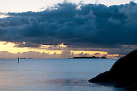 Dawn breaks with storm clouds hovering over Gustavsvärn Lighthouse at Hanko, Finland.