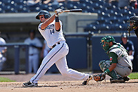 West Michigan Michigan Whitecaps catcher Drew Longley (14) follows through on his swing against the Fort Wayne TinCaps during the Midwest League baseball game on April 26, 2017 at Fifth Third Ballpark in Comstock Park, Michigan. West Michigan defeated Fort Wayne 8-2. (Andrew Woolley/Four Seam Images)