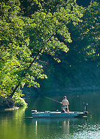 A fisher cast his rod and reel across nearly still waters on Hoover Reservoir near Galena, Ohio.