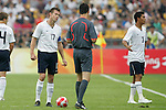 13 August 2008: Brian McBride (USA) (17)complains to referee Wolfgang Stark (center)after Michael Orozco (USA) (3) received a red card early in the first half.  The men's Olympic team of Nigeria defeated the men's Olympic soccer team of the United States 2-1 at Beijing Workers' Stadium in Beijing, China in a Group B round-robin match in the Men's Olympic Football competition.