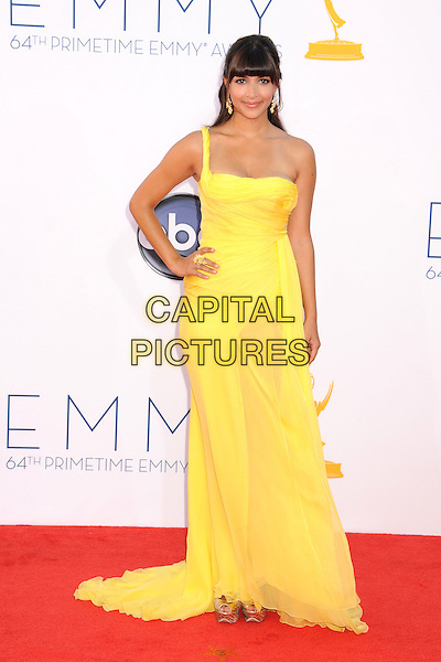 Hannah Simone.The 64th Anual Primetime Emmy Awards - Arrivals, held at Nokia Theatre L.A. Live in Los Angeles, California, USA..September 23rd, 2012.emmys full length dress yellow one shoulder hand on hip.CAP/ADM/BP.©Byron Purvis/AdMedia/Capital Pictures.