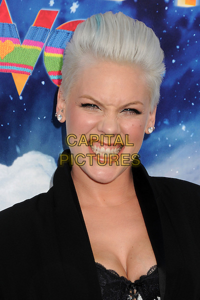 Alecia Moore aka Pink.The World Premiere of 'Happy Feet Two' held at The Grauman's Chinese Theatre in Hollywood, California, USA..November 13th, 2011.headshot portrait pinnk piink black cleavage white lace teeth funny .CAP/ADM/BP.©Byron Purvis/AdMedia/Capital Pictures.