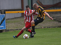 Jamie McHarrie challenges Craig Dorrat in the Huntly v Wigtown & Bladnoch William Hill Scottish Cup 1st Round match, at Christie Park, Huntly on 25.8.12...