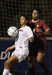 03 November 2010: Virginia's Gloria Douglas (7) and Boston College's Chelsea Regan (2). The Boston College Eagles defeated the Virginia Cavaliers 1-0 in an ACC Women's Soccer Tournament quarterfinal game at Koka Booth Stadium at WakeMed Soccer Park in Cary, NC.