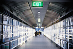 Blurred figures walking in an airport passageway