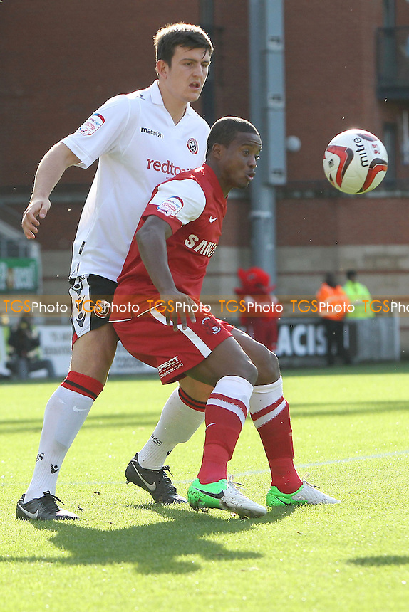 Kevin Lisbie of Leyton Orient shields the ball from Harry Maguire of Sheffield United - Leyton Orient vs Sheffield United - NPower League One Football at the Matchroom Stadium, Brisbane Road, London - 06/10/12 - MANDATORY CREDIT: Gavin Ellis/TGSPHOTO - Self billing applies where appropriate - 0845 094 6026 - contact@tgsphoto.co.uk - NO UNPAID USE.
