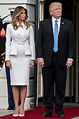 U.S. President Donald Trump stands with his wife Melania Trump, left, before greeting Benjamin Netanyahu, Israel's prime minister, not pictured, at the South Portico of the White House in Washington, D.C., U.S., on Wednesday, Feb. 15, 2017. Netanyahu is trying to recalibrate ties with Israel's top ally after eight years of high-profile clashes with former President Barack Obama, in part over Israel's policies toward the Palestinians. <br /> Credit: Andrew Harrer / Pool via CNPP