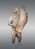 9th century BC Giants of Mont'e Prama  Nuragic stone statue of a boxer, Mont'e Prama archaeological site, Cabras. 2014 excavation. Civico Museo Archeologico Giovanni Marongiu - Cabras, Sardinia. Grey background