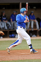 Catcher Tyler Lancaster (15) of the Spartanburg Methodist College Pioneers hits in a junior college game against Surry Community College on January 31, 2016, at Mooneyham Field in Spartanburg, South Carolina. (Tom Priddy/Four Seam Images)