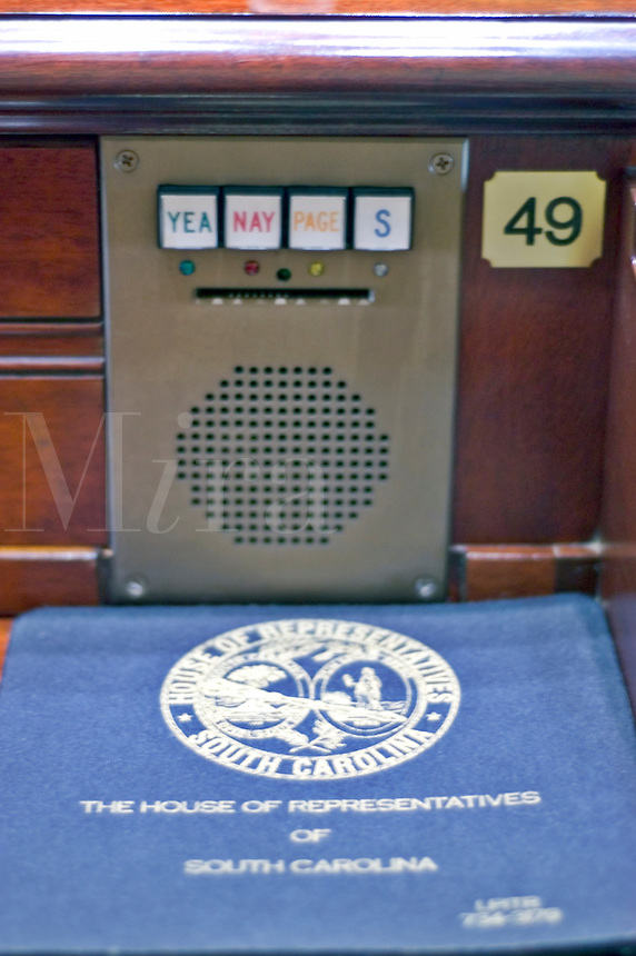 Electronic voting is used in the South Carolina House of Representatives, via this unit, situated at each desk.  Notice the slot for the ID card, which must be inserted prior to each vote.