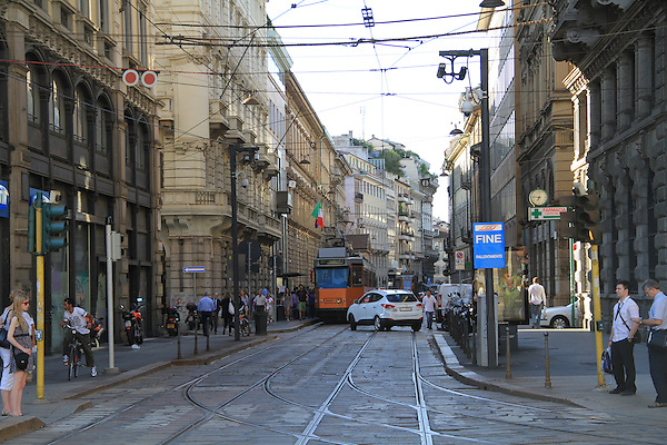 Railroad and street in downtown Milano, Italy.