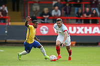 Lewis Cook (AFC Bournemouth) of England moves away from Malcom of Brazil during the International match between England U20 and Brazil U20 at the Aggborough Stadium, Kidderminster, England on 4 September 2016. Photo by Andy Rowland / PRiME Media Images.