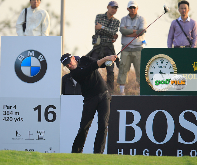 Jamie Donaldson (WAL) tees off the 16th tee during Sunday's Final Round of the 2014 BMW Masters held at Lake Malaren, Shanghai, China. 2nd November 2014.<br /> Picture: Eoin Clarke www.golffile.ie