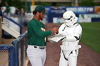 Lynchburg Hillcats Bobby Bradley (44) takes an autograph book from a Storm Trooper that he got from a young fan on Star Wars night before a game against the Wilmington Blue Rocks on June 3, 2016 at Judy Johnson Field at Daniel S. Frawley Stadium in Wilmington, Delaware.  Lynchburg defeated Wilmington 16-11 in ten innings.  (Mike Janes/Four Seam Images)